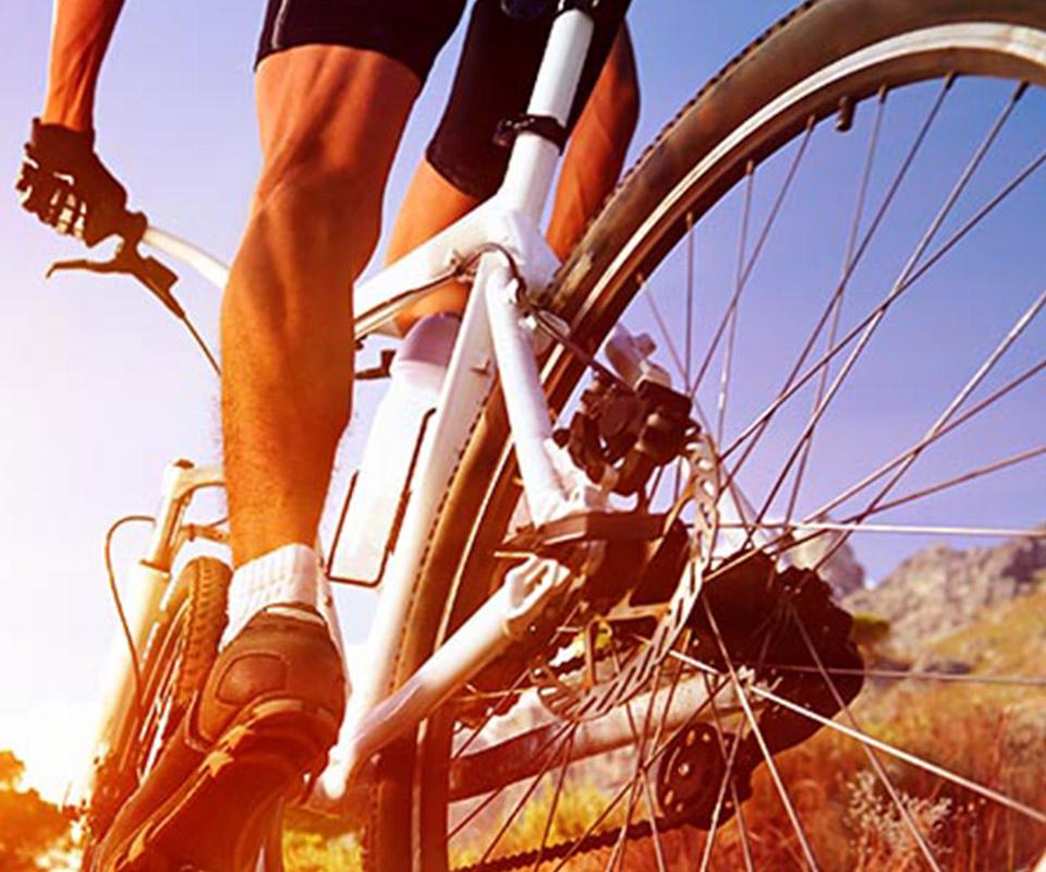 Close up photo of guy riding white bike