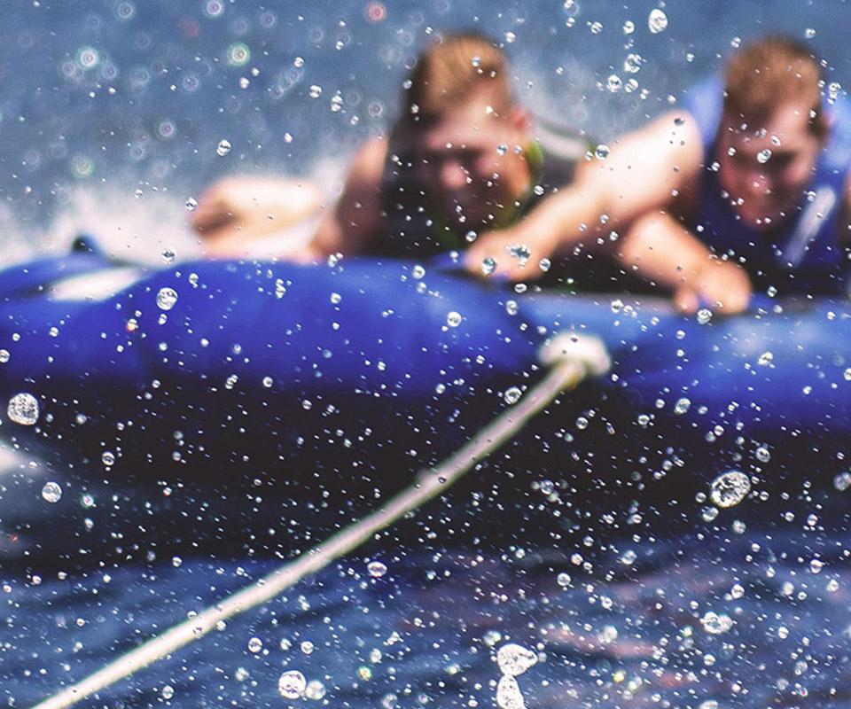 Kids on blue water tube