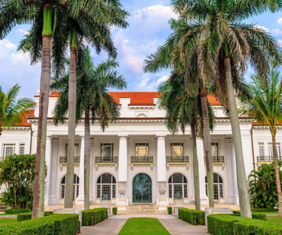 Flagler Museum exterior with palm trees