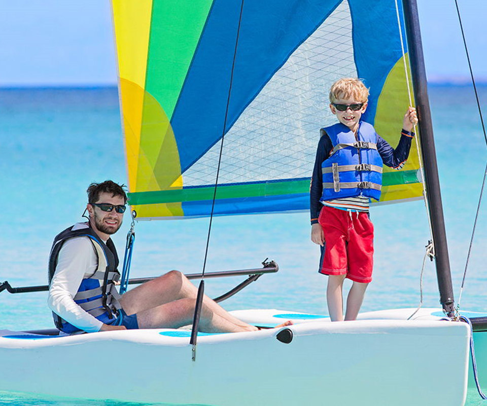 Father and son sailing on a Hobie Cat