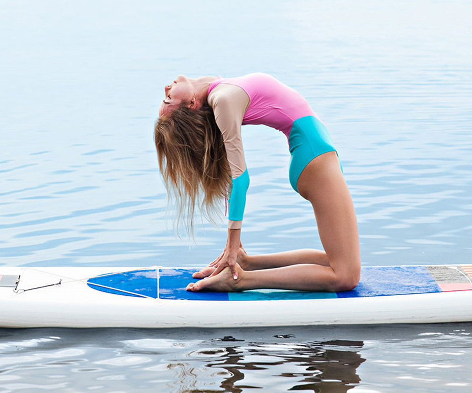 Girl doing yoga on a paddle board