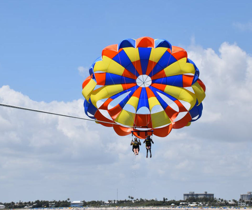 Couple parasailing with blue sky