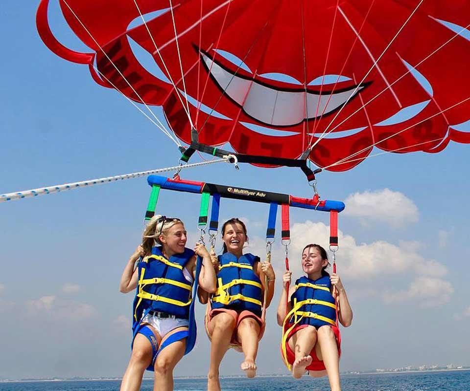 3 girl friends parasailing in Palm Beach Florida