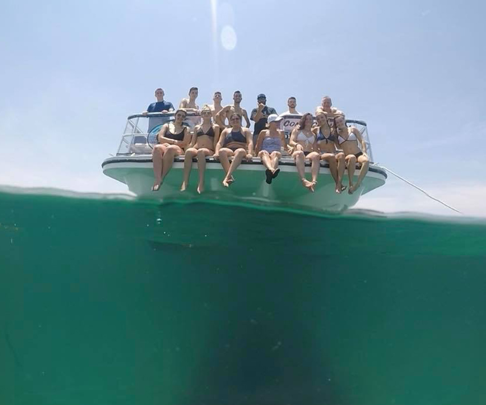 People on front of boat for photo