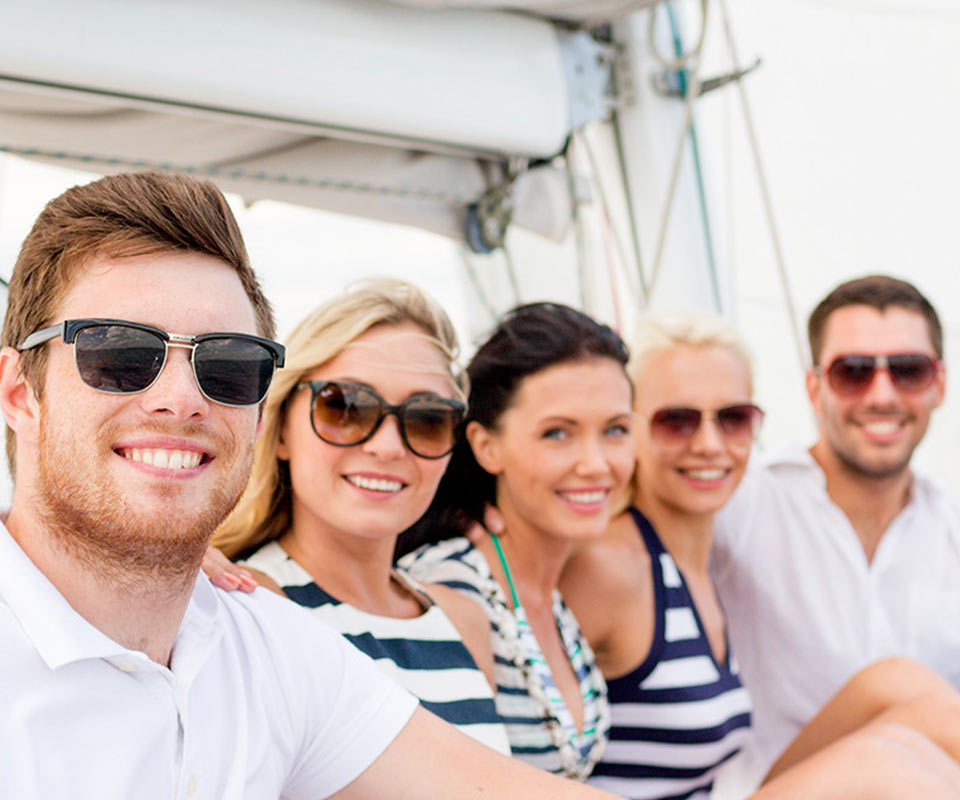 Friends having fun a on private boat charter