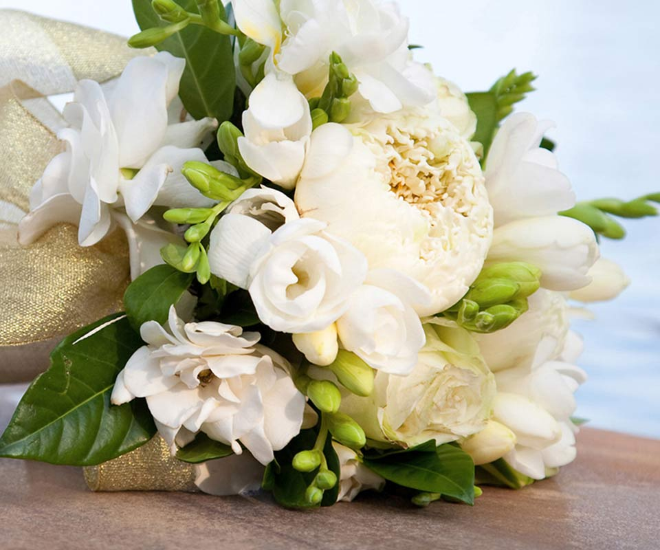 Bouquet of white wedding flowers on a dock
