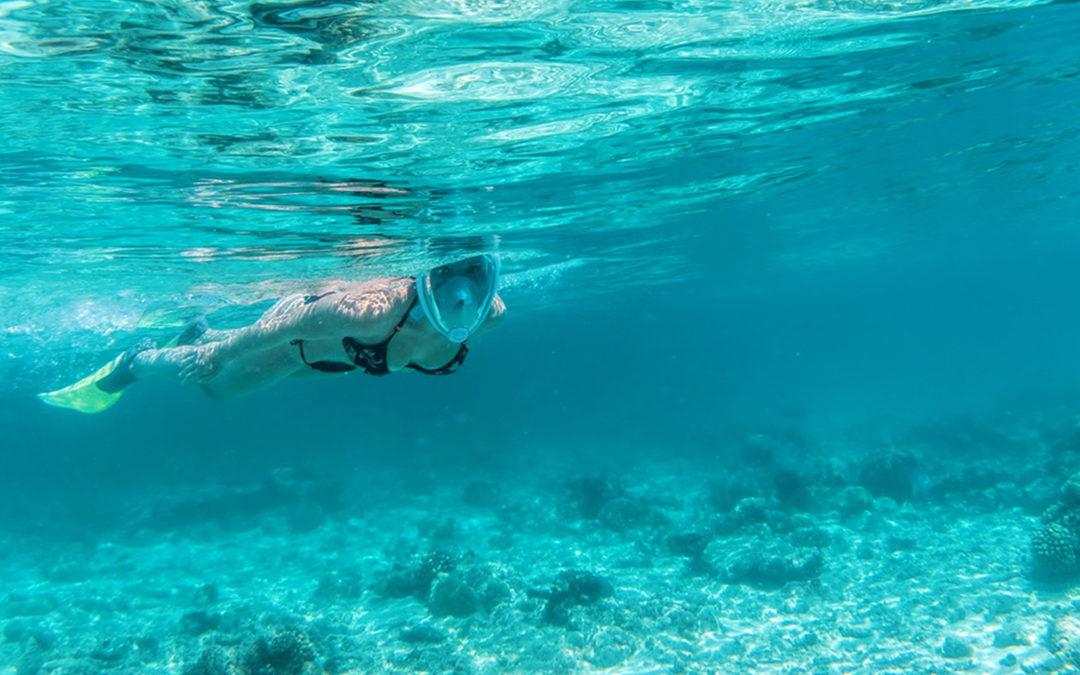 Girl in black bikini snorkeling