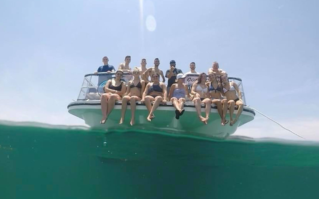 Group on front of a boat