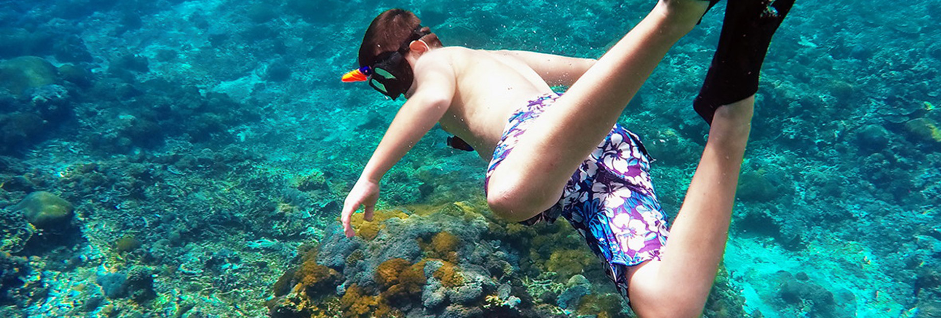 Kid snorkeling in clear water