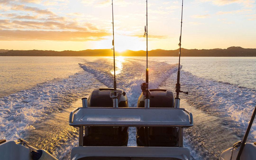 Sunset behind fishing boat