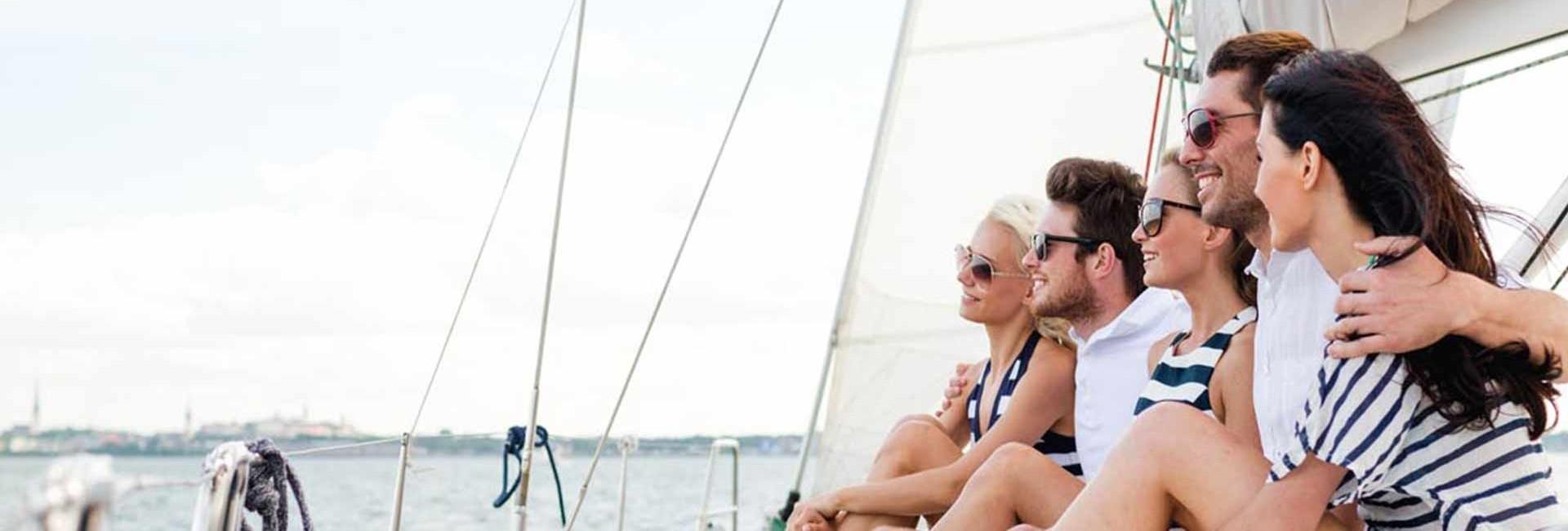 Friends having fun a on a sailboat