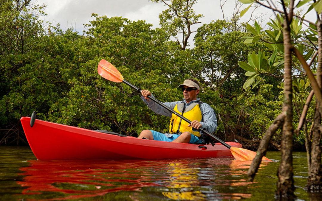 Man in red kayak