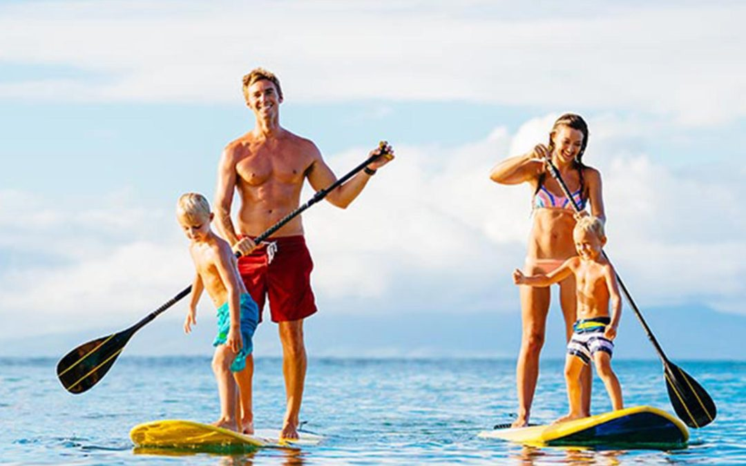 Family paddle boarding West Palm Beach