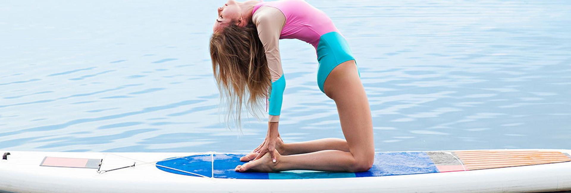 Woman doing yoga on paddle board