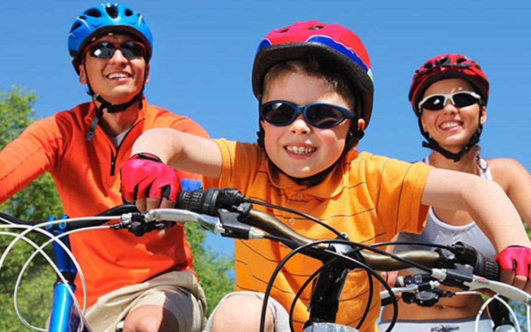 Family riding bikes Palm Beach