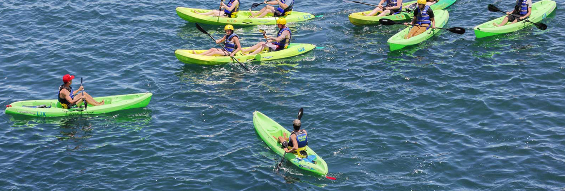 Group in green kayaks