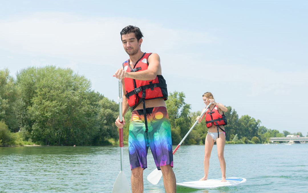 Couple paddle boarding
