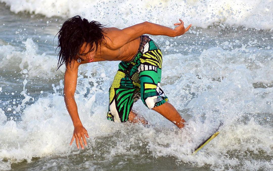 Dude skimboarding Palm Beach
