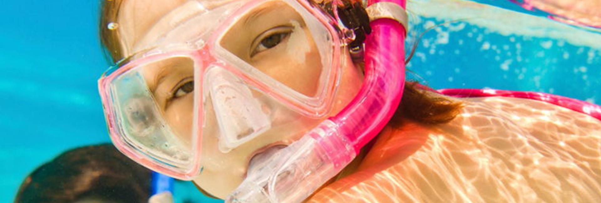 Little girl in pink snorkel gear