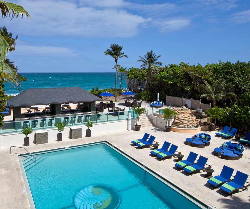 Jupiter Beach Resort & Spa pool and beach